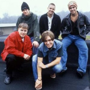 Take That original line up. Mark Owen, Jason Orange, Robbie Williams, Gary Barlow, Howard Donald